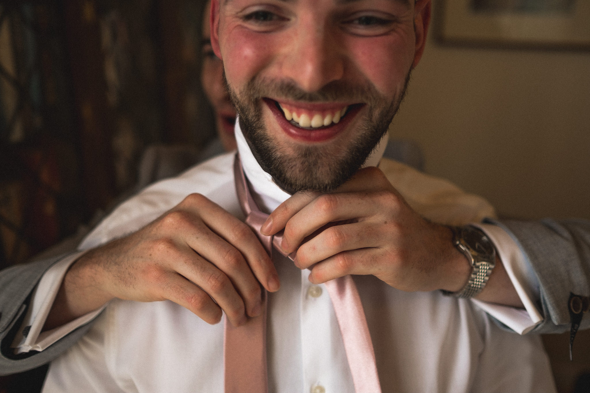 Reportage photo of groomsmen getting ready in style for wedding at Bert's Barrow Farm