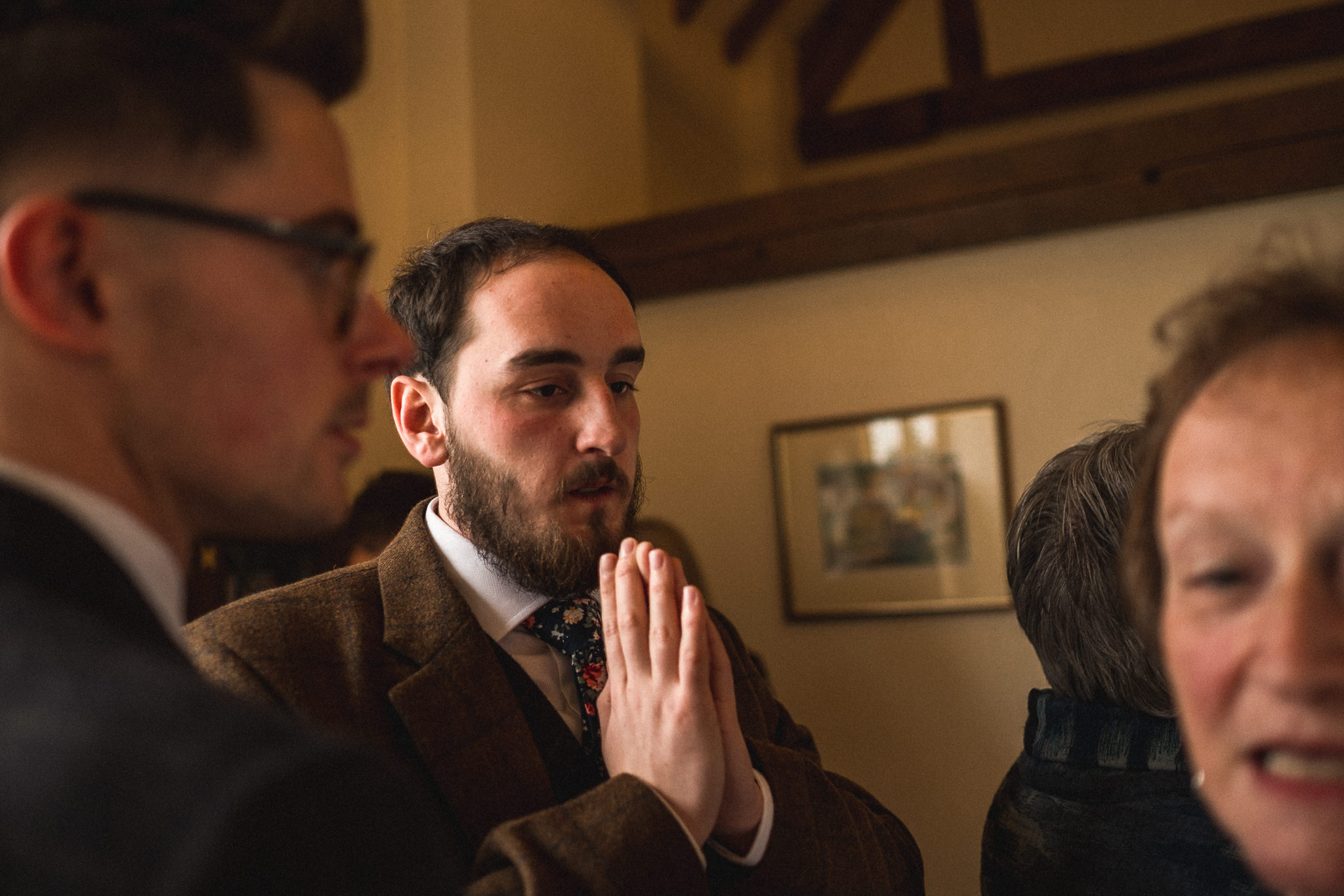 Alternative candid wedding photography of groom getting ready in style for wedding at Berts Barrow Farm