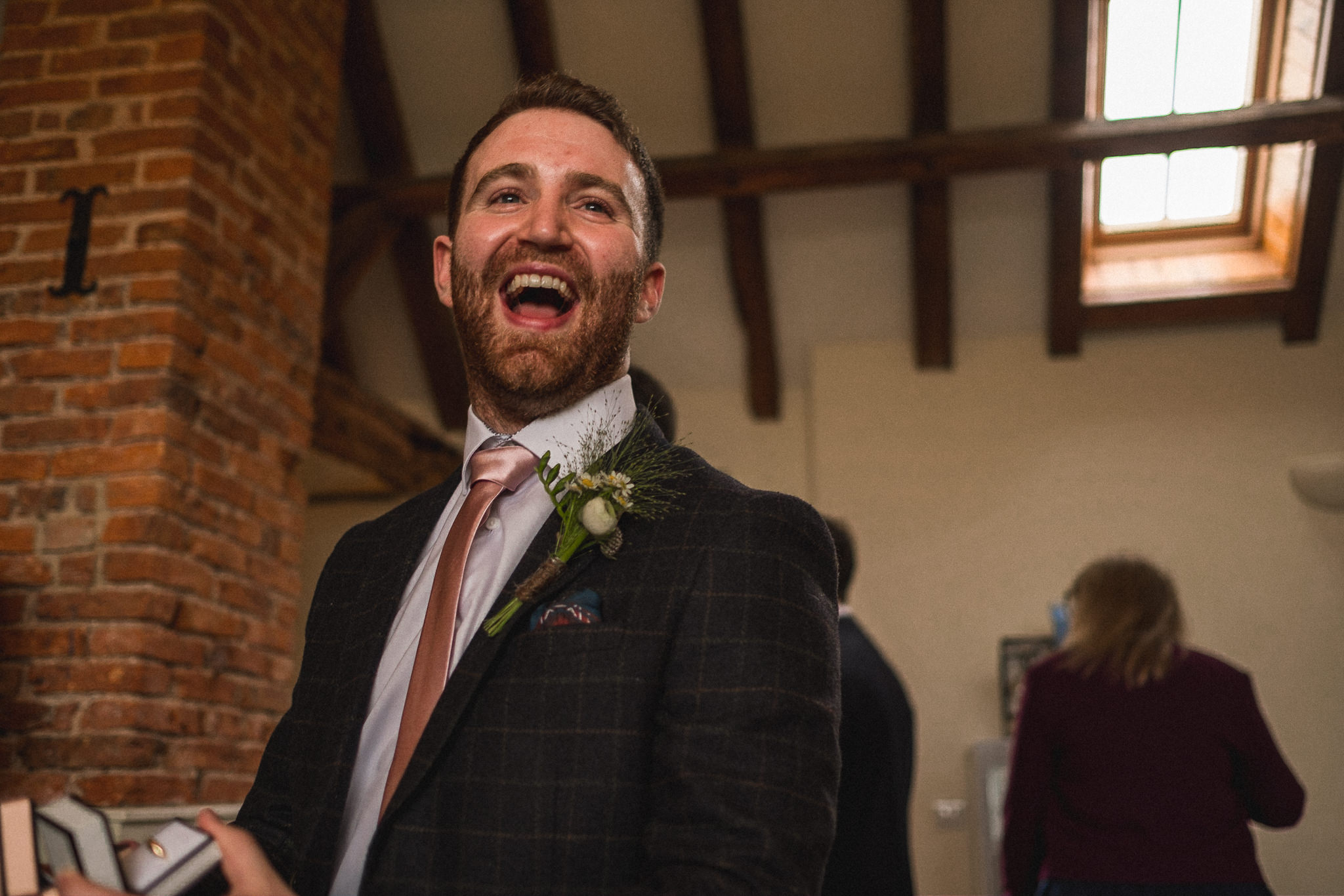 Quirky Candid wedding photography of groomsmen getting ready in style for wedding at Berts Barrow Farm