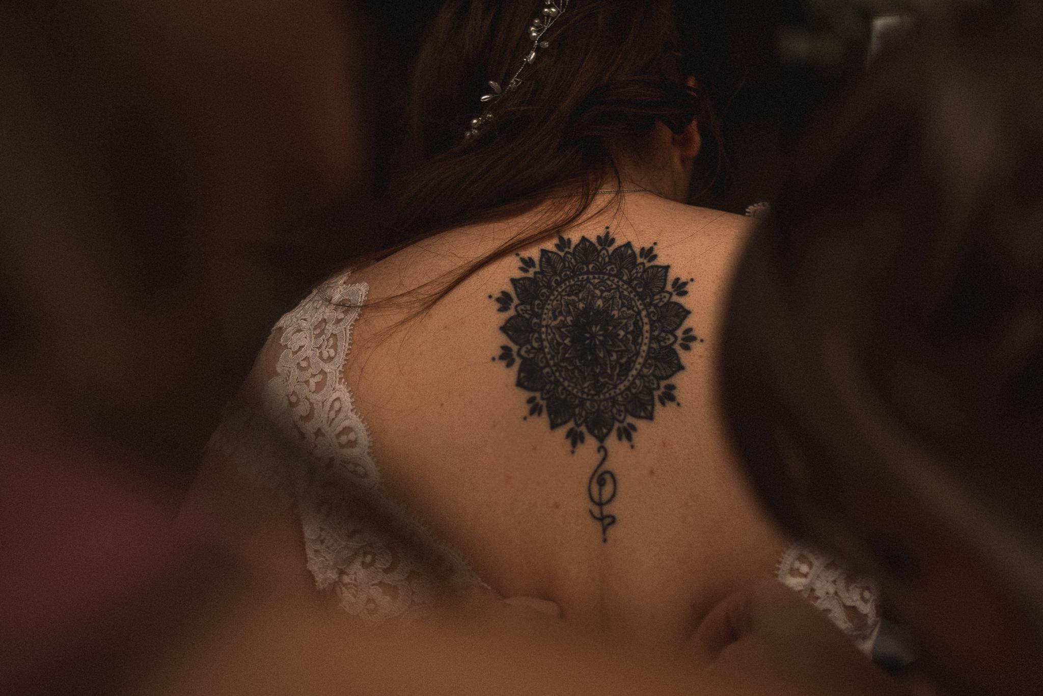 Bridal prep photography of mandala tattoo on bride attending Bert's Barrow wedding in Leeds, Yorkshire