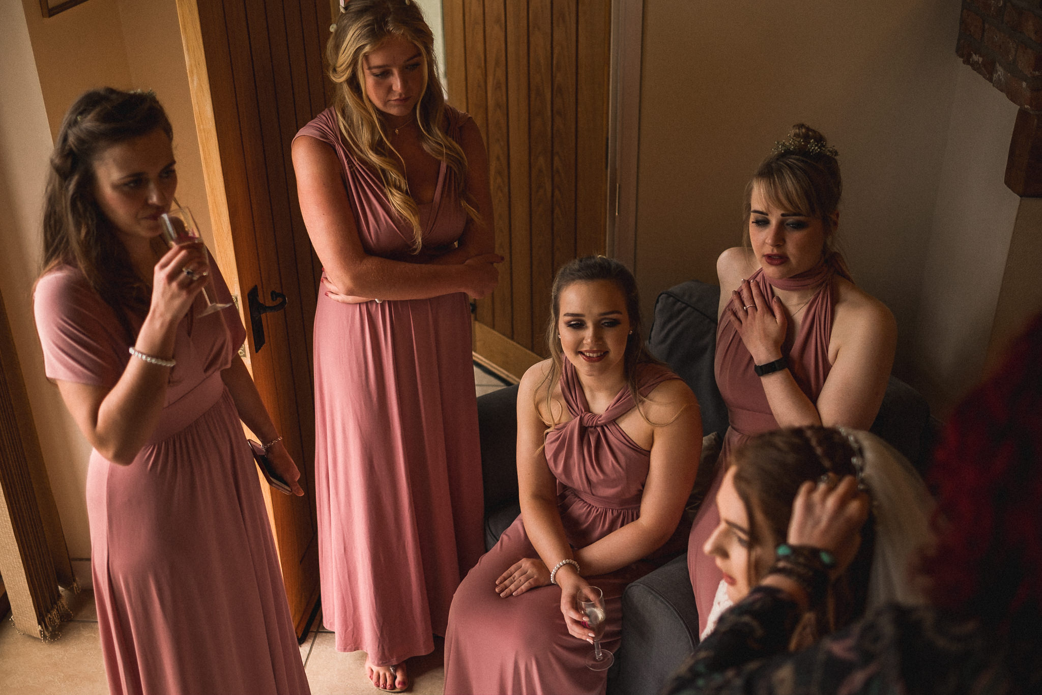 Candid wedding photography of bridal party getting ready in style for wedding at Berts Barrow Farm