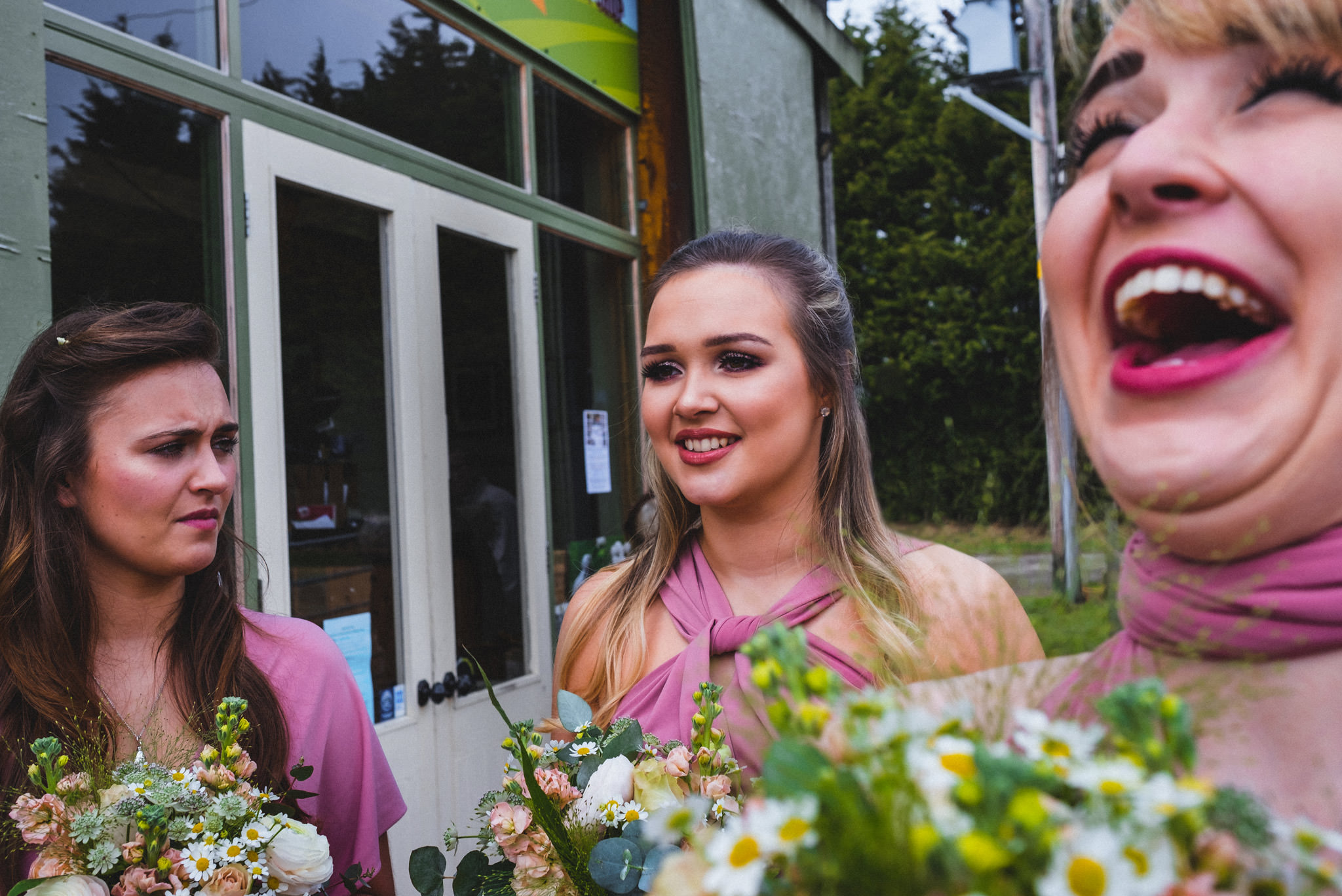 Candid photo of bridal party laughing