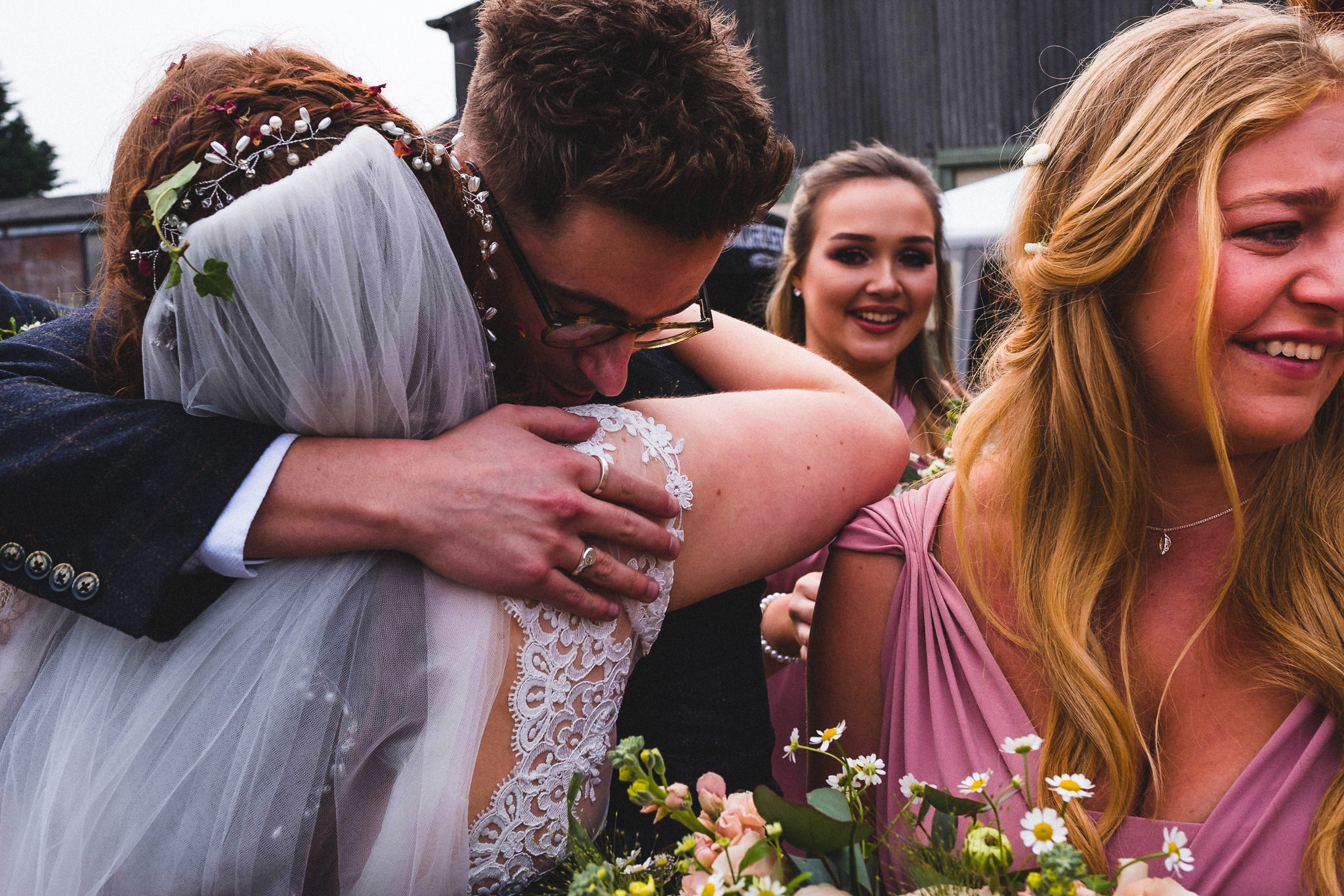 Couple hugging after getting married at Berts Barrow farm