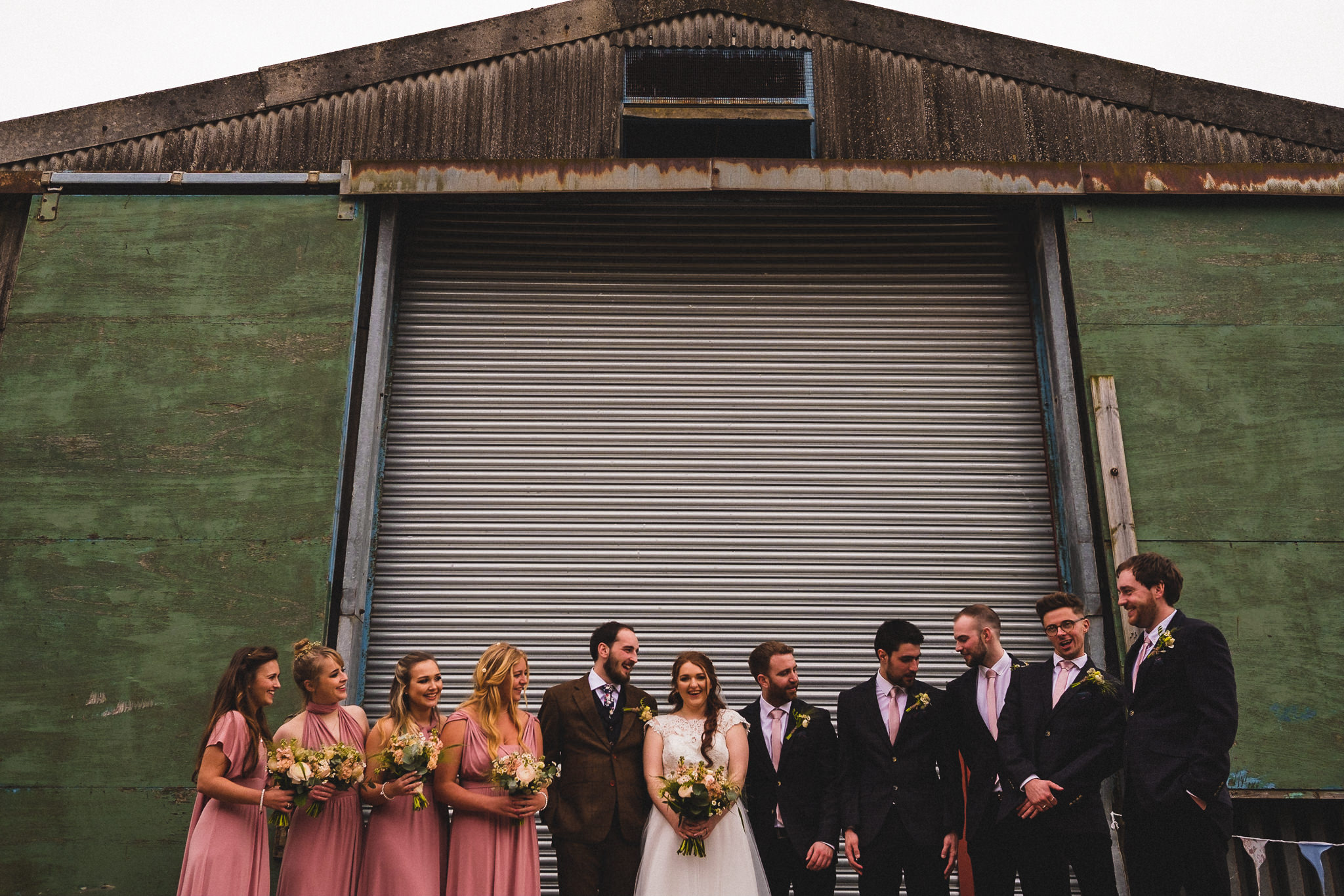 Formal photo of bridal party laughing