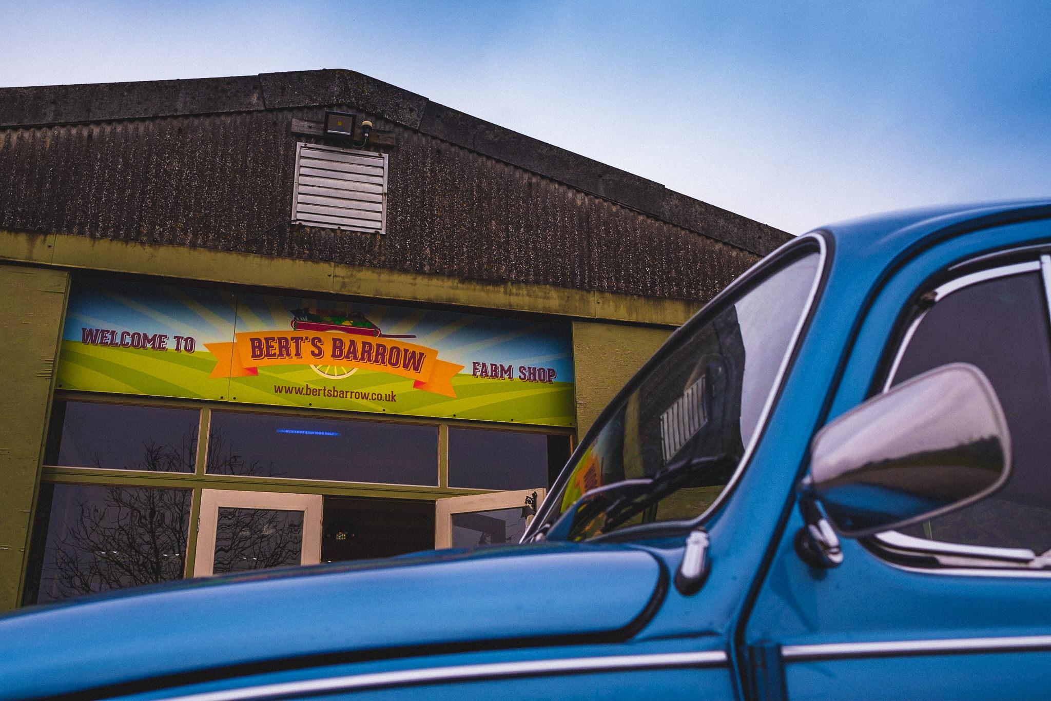 Vintage classic car parked outside Berts Barrow Farm