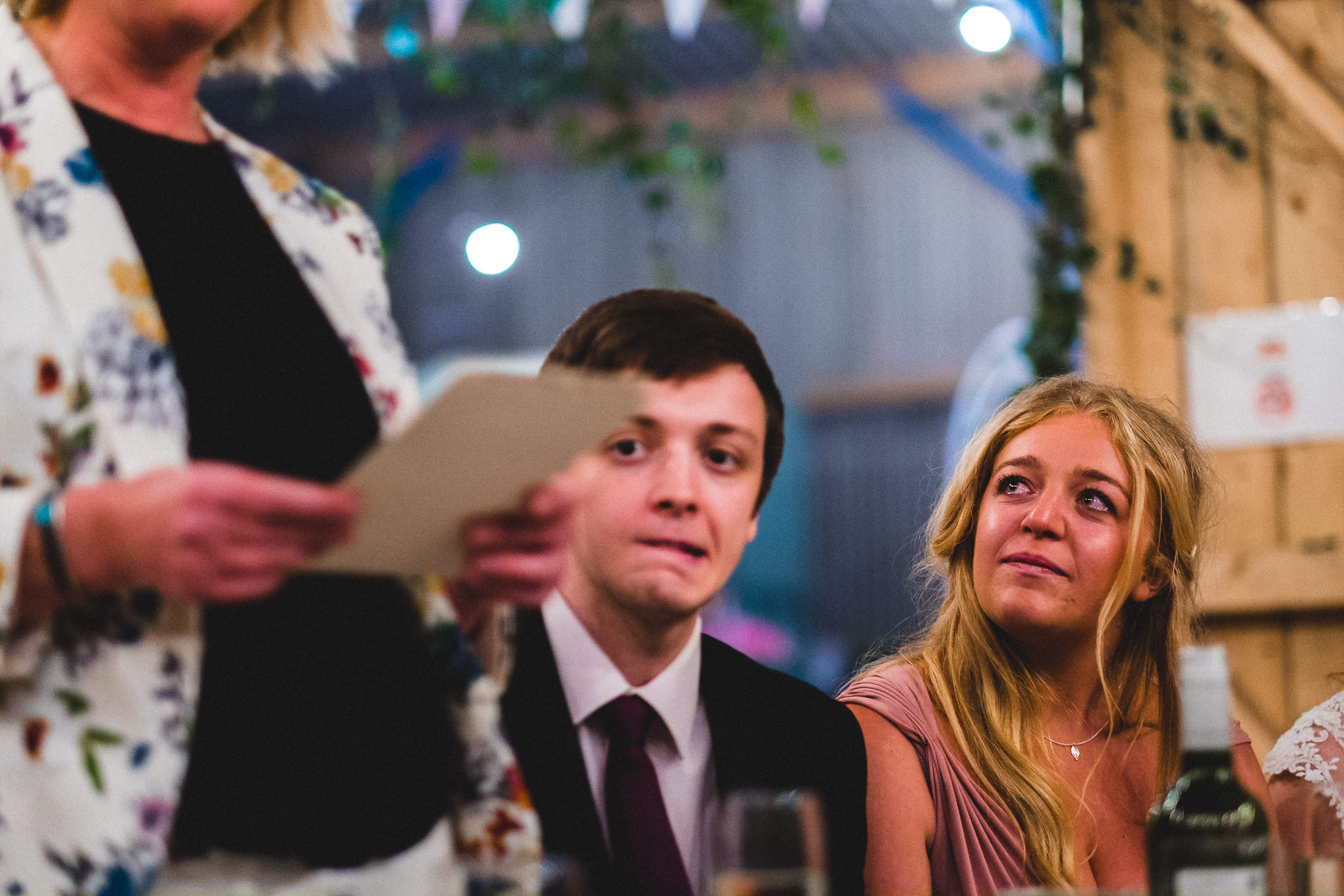 Groom giving emotional wedding speech