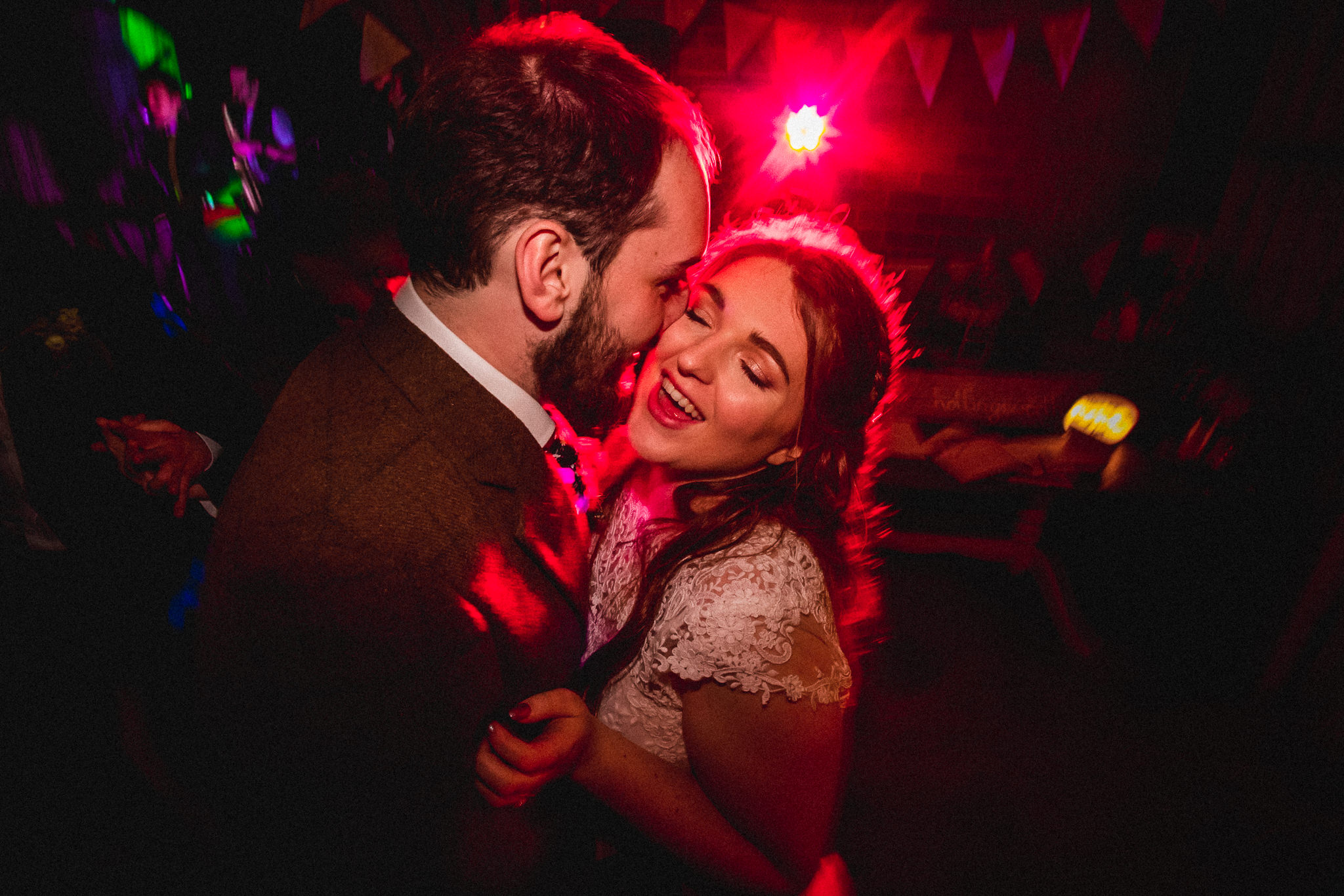 Crazy bride and groom dancing at wedding after party at Bert's Barrow Farm