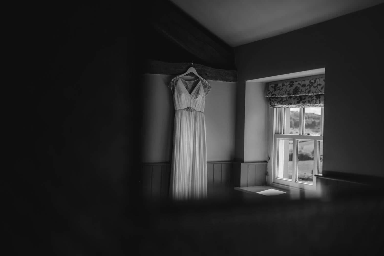 Wedding dress hanging in the window