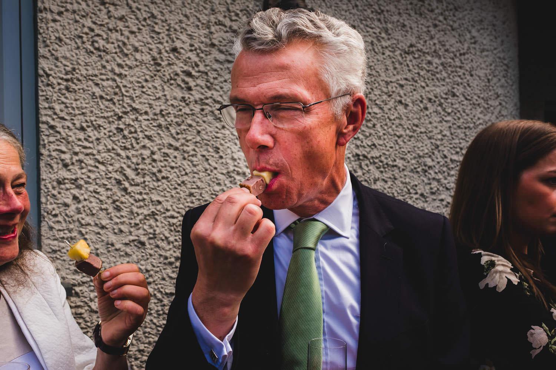 Man eating canapes