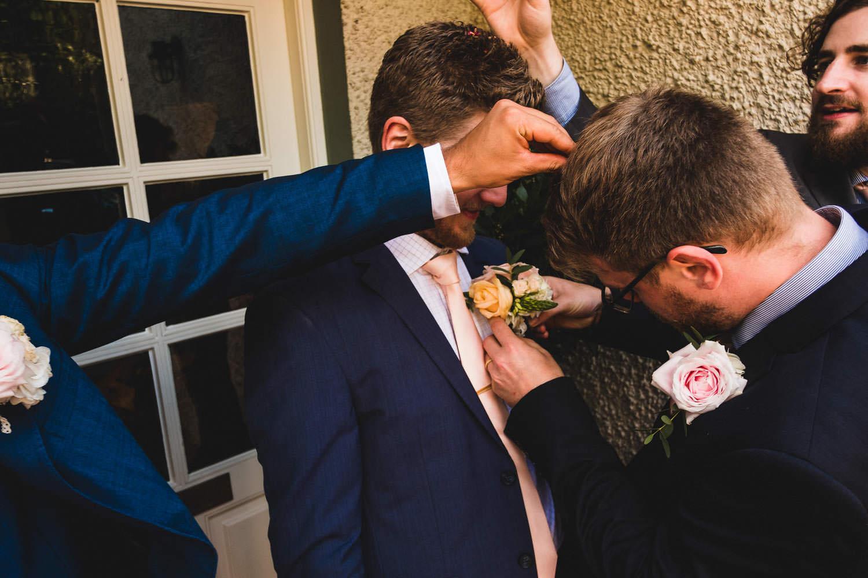 Documentary wedding photograph of groom