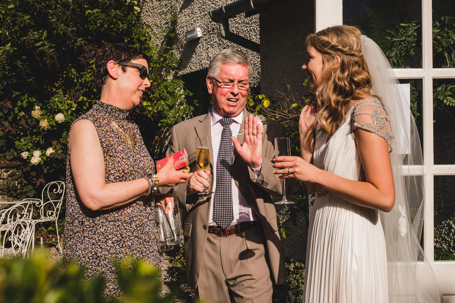 Candid photograph of father of the bride