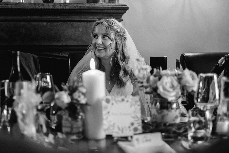 Bride smiling at groom speech