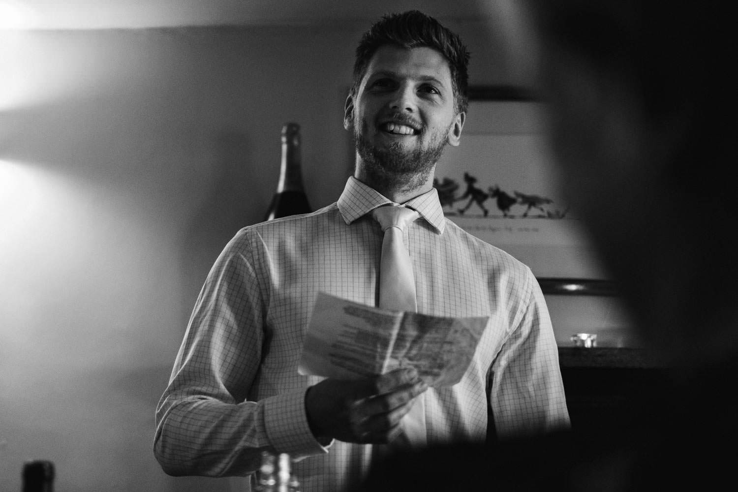 Candid photograph of groom giving his speech