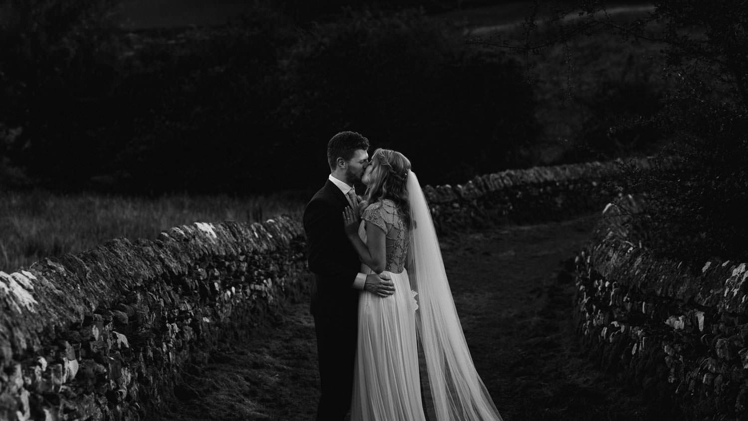 Modern portrait of bride and groom at The Punch Bowl Inn, Lake District