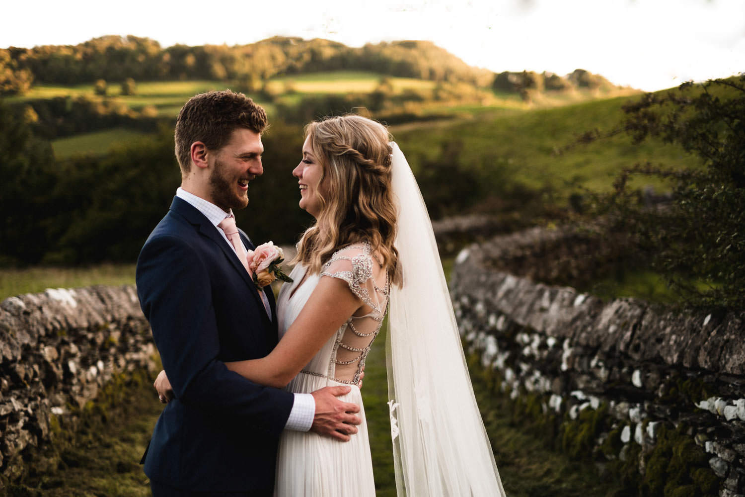 Alternative modern portrait of bride and groom at The Punch Bowl Inn, Lake District