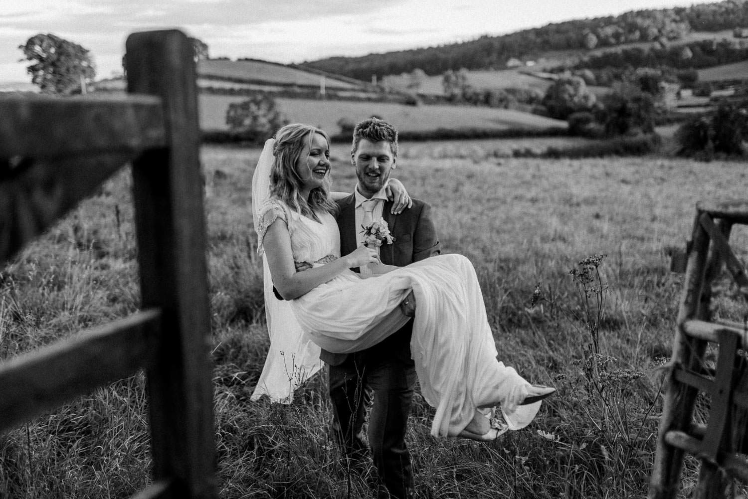 Quirky portrait of bride and groom at The Punch Bowl Inn, Lake District